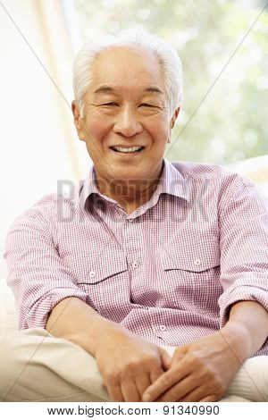 Senior Asian man at home