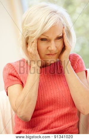 Mid age woman with headache
