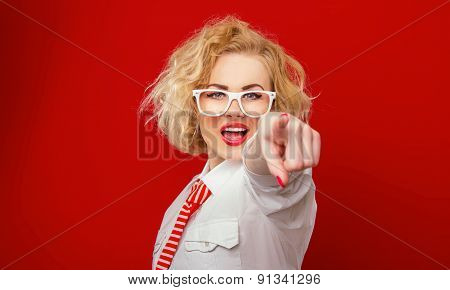 Woman Pointing At Something , Isolated On Red. Focus On Face