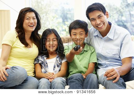 Asian family watching television