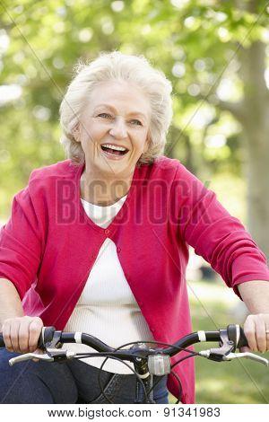 Senior woman riding bike
