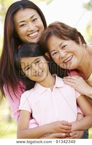 Portrait multi-generation Asian females in park