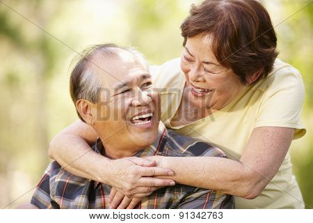 Portrait romantic senior Asian couple outdoors