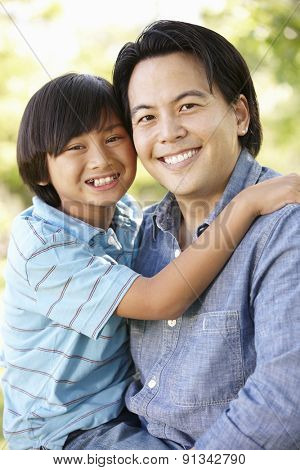Portrait Asian father and son outdoors