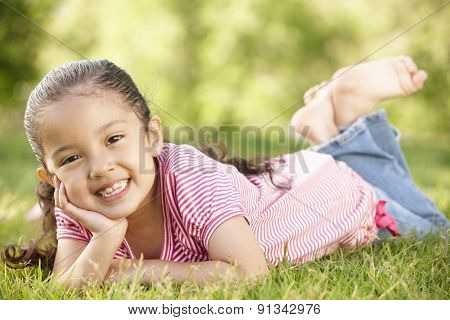 Young Hispanic Girl Relaxing In Park