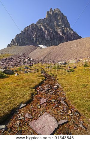 Alpine Stream Below A Isolated Peak