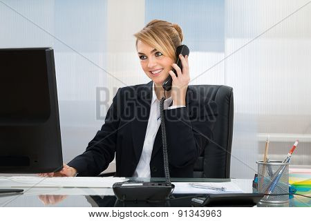 Happy Businesswoman Talking On Telephone