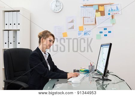 Businesswoman With Computer In Office