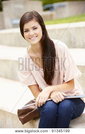 Teenage student working outdoors