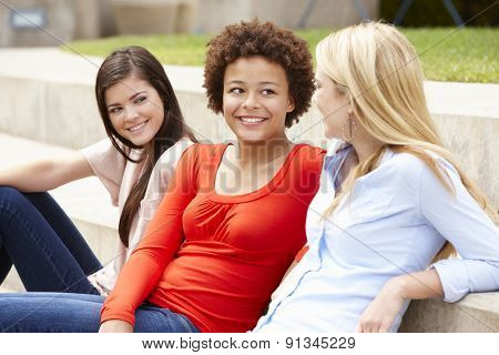 Teenage student girls chatting outdoors