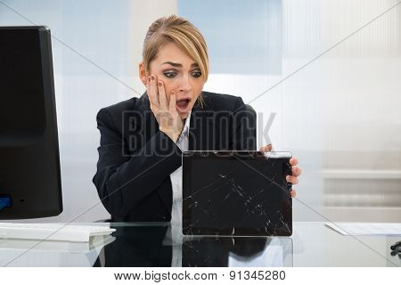Businesswoman Holding Broken Digital Tablet