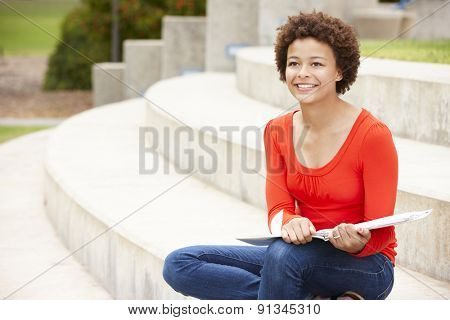 Mixed race student working outdoors