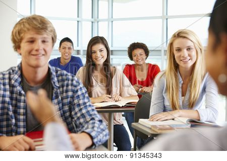 Multi racial teenage pupils in class