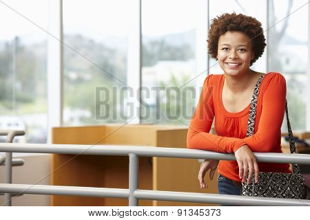 Mixed race student girl indoors
