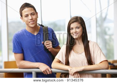 Teenage student girl and boy indoors
