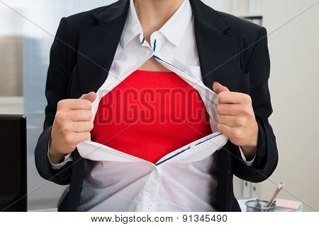 Businesswoman Tearing Her Shirt Showing Red Costume