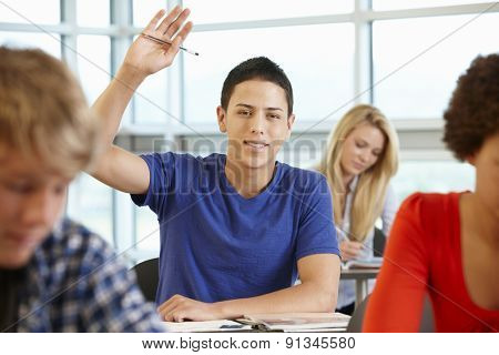 Hispanic student asking question in class
