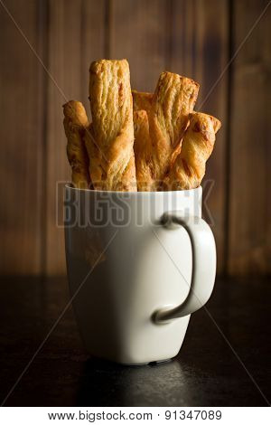 bread sticks with cheese in cup