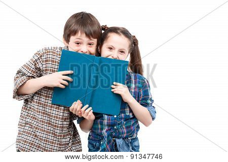 Brother and sister posing with a book