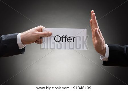 Close-up Of Two Hand's Holding Offer Paper