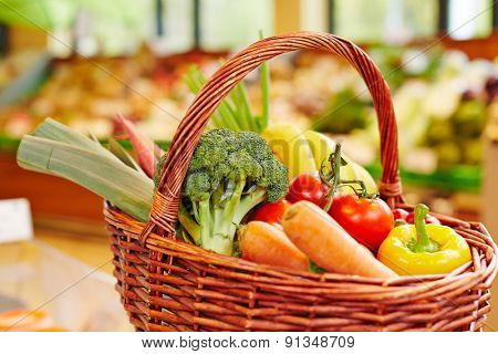 Colorful fresh vegetables in a shopping basket in a supermarket