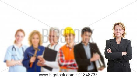 Business woman standing in front of a team with different occupations and trades