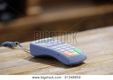 The image of a plastic card reader on a counter
