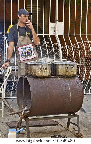 Man Making Food At Street Market Stand