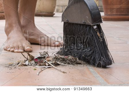 Barefoot Closeup Sweeping Outdoor Patio Floor