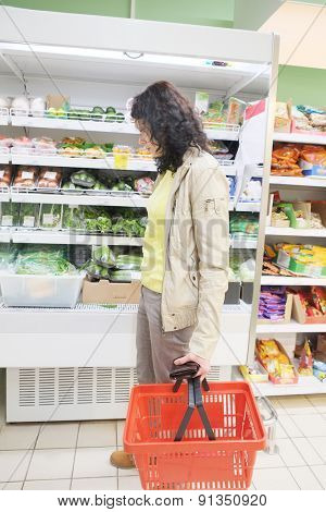 MOSCOW, RUSSIA  -  APRIL 09, 2015: Supermarket Pyaterochka with the most affordable prices. Russia's largest retailer. Woman shopping in supermarket