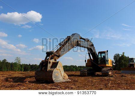 excavator under blue sky