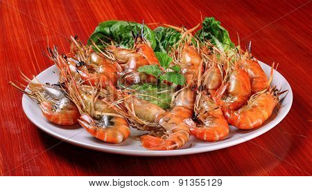 Plate Of Grilled Shrimps With Spicy Sauce