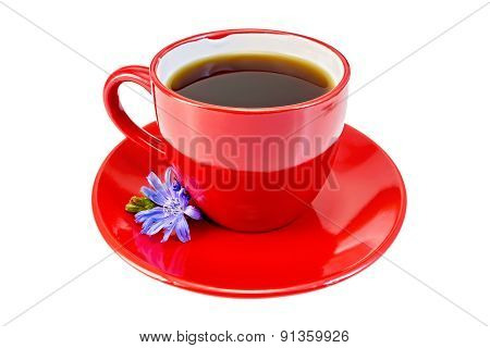 Chicory drink in red cup with blue flower