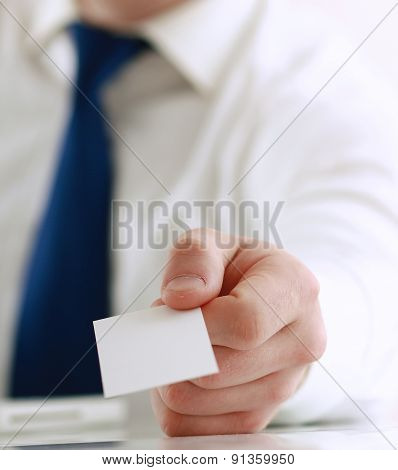 Portrait of young handsome business man holding blank white business card