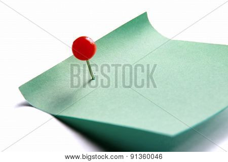 Green paper note on white background isolated.