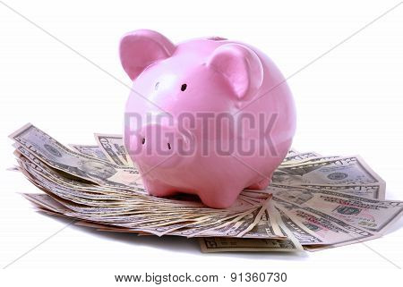 piggy bank on dollars, isolated on white background