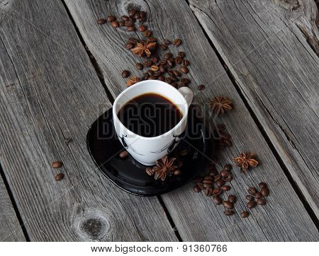 Coffee In A Coffee Cup In An Environment Of Coffee Grains And Anise Asterisks