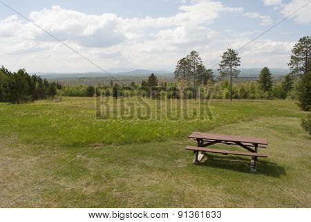 Picnic Table Overlooking Distant Mountains