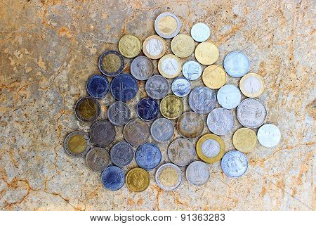 various coins collection on a rough surface background