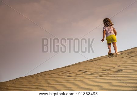 Running up the sand dunes