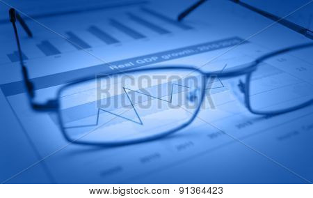 Glasses On Blue Financial Chart And Graph, Success Concept