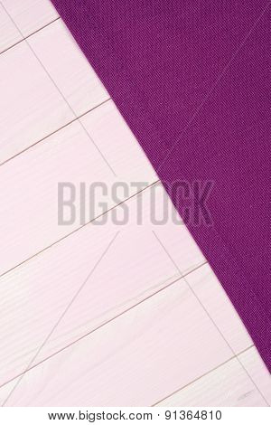 Purple Towel Over Pink Wooden Table