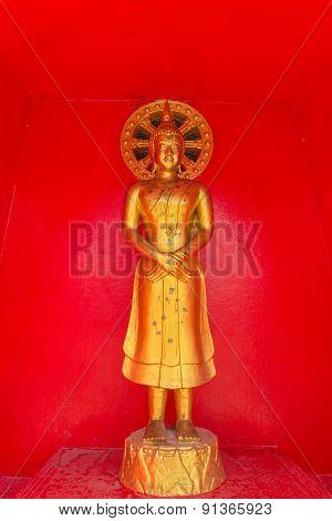 the standing gold buddha statue