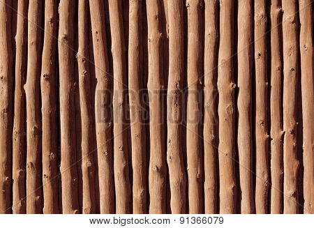 Mediterranean wooden trunks wall texture in Majorca