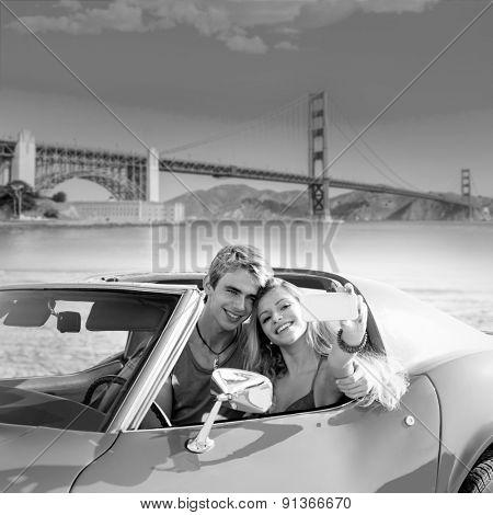 selfie of young teen couple at convertible car in San Francisco Golden Gate Bridge photo mount