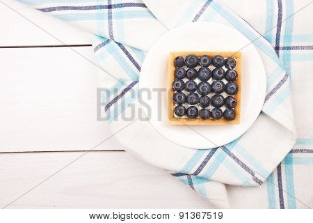 Tartlet with bluebarries and custard