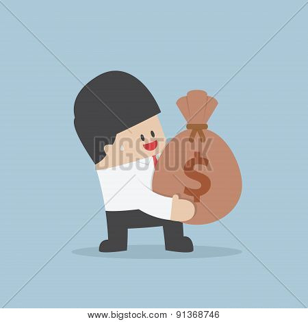 Businessman Holding A Money Bag With Dollar Sign