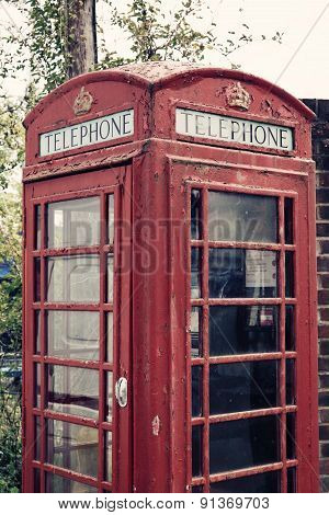 A Cropped Photo Of A British Telephone Booth With An Applied Vintage Filter