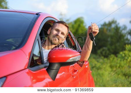Man Inside New Red Car With Keys.