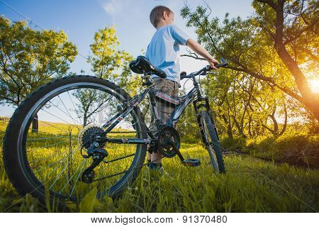 happy funny kid on bicycle. Active Leisure